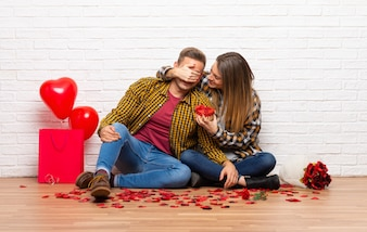 Couple in valentine day at indoors holding gift box
