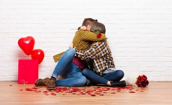 Couple in valentine day at indoors with flowers