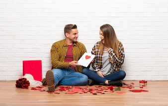 Couple in valentine day at indoors with valentines day card
