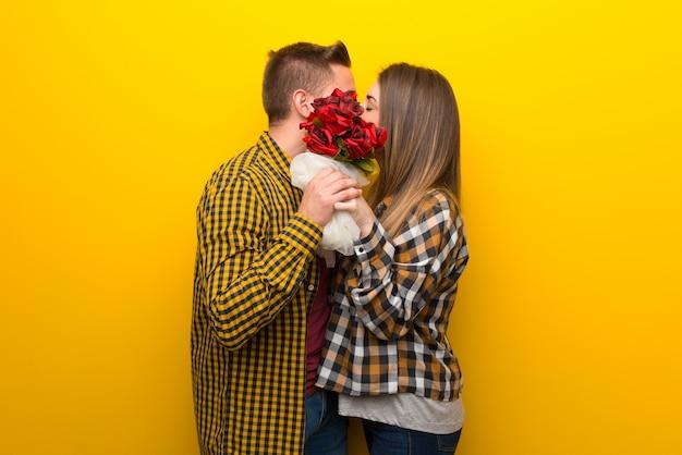 バレンタインの日に花とキスをするカップル