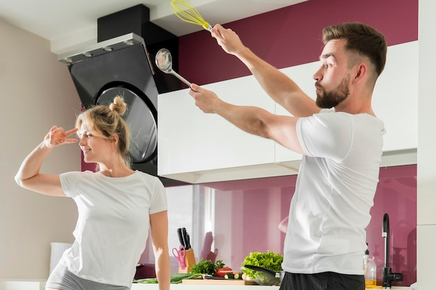Couple indoors trying to cook