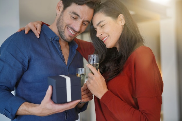 Couple inlove exchanging gifts for valentin'es day