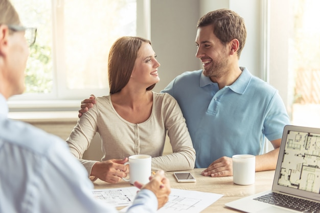 Couple is drinking coffee and smiling
