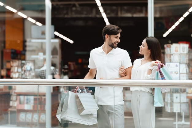 Couple is relaxing, happy after shopping.
