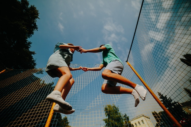 Couple jumping on trampoline