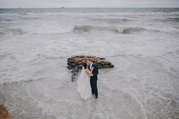 Couple kissing on the beach