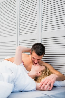 Couple kissing in soft bed