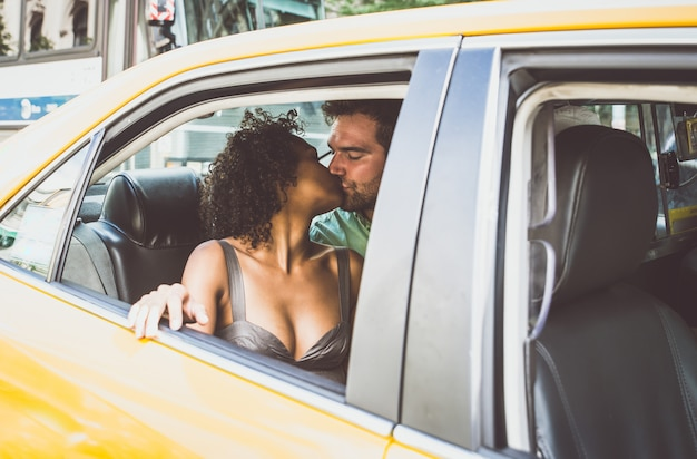 Couple kissing inside a taxi