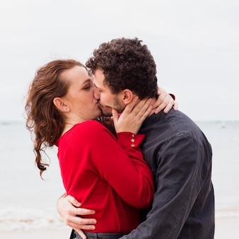 Couple kissing on sea shore