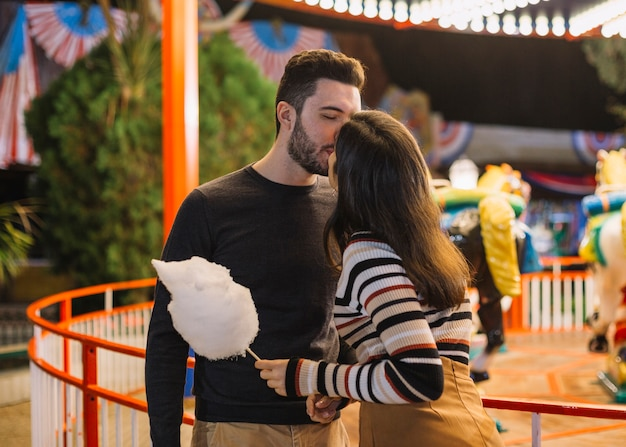Couple kissing in a theme park