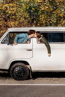 Couple kissing in a van windows
