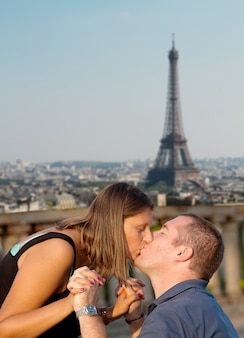A couple kissing with paris