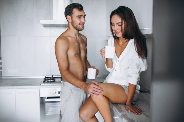 Couple at kitchen drinking coffee in the morning