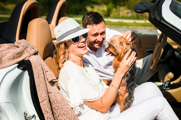 Couple laughing at dog