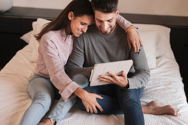 Couple laughing at tablet