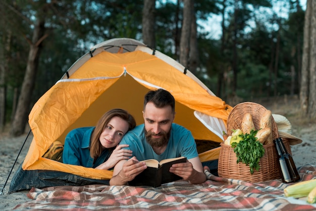 Couple laying down and reading