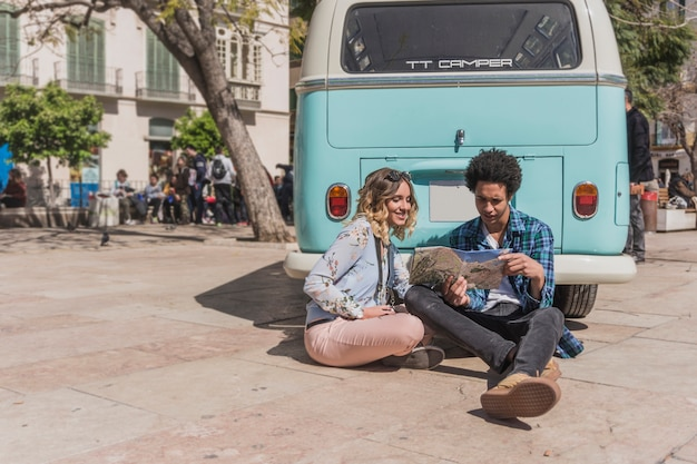 Couple leaning on vintage bus
