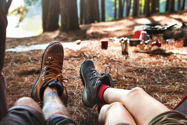 Couple legs relaxing camping outdoors concept
