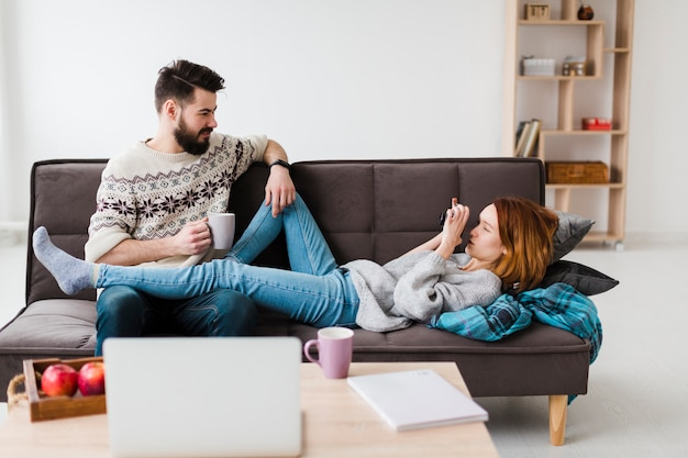 Couple in living room drinking coffee