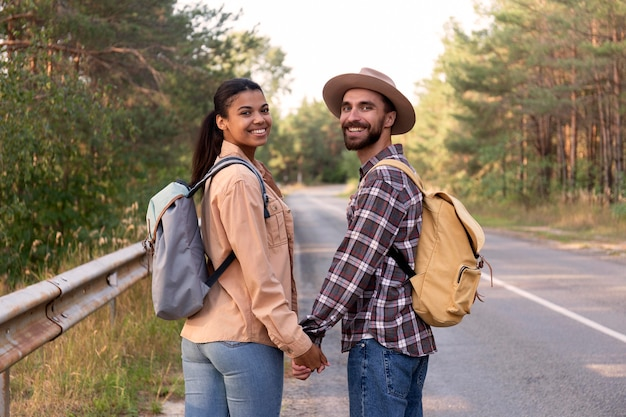 Couple looking back while holding hands