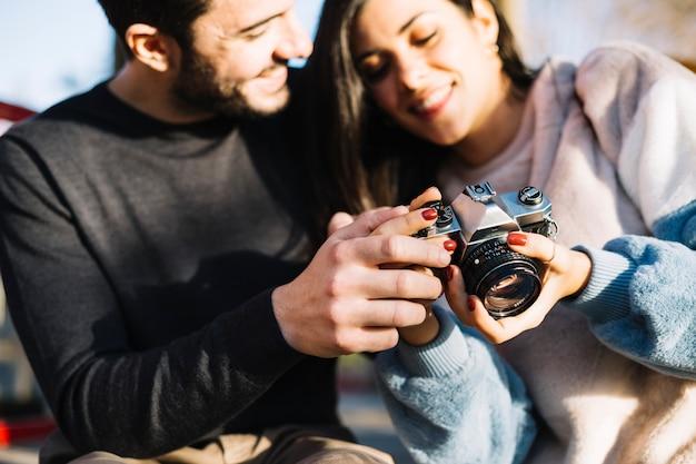 Couple looking at a camera