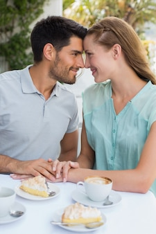 Couple looking at each other at coffee shop