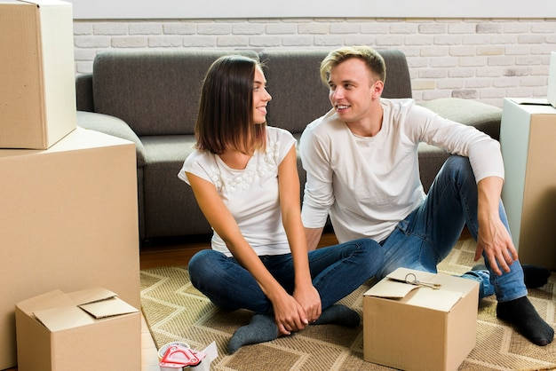 Couple looking at each other while packing