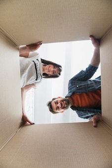 Couple looking inside box