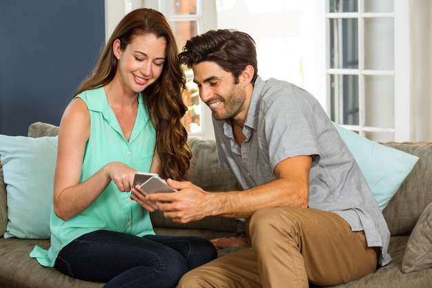 Couple looking at mobile phone and smiling