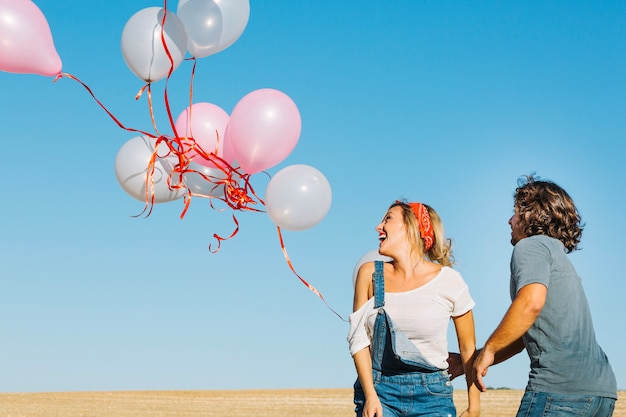 Couple looking at released balloons