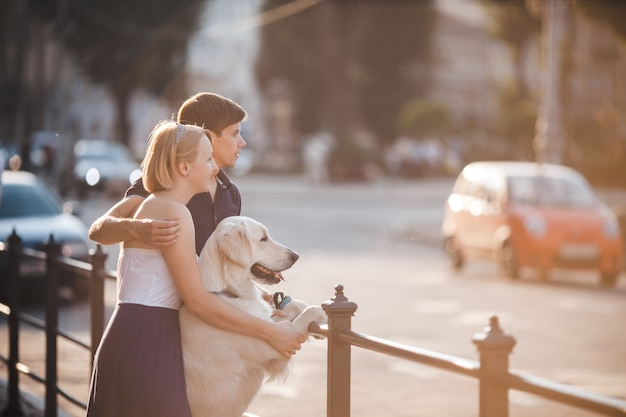 Couple looking at the road with their dog