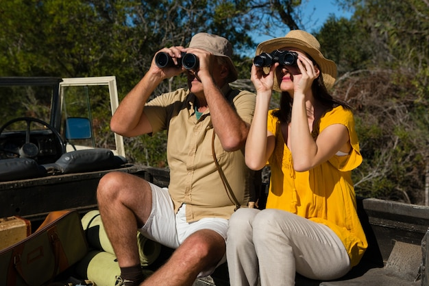 Couple looking through binoculars