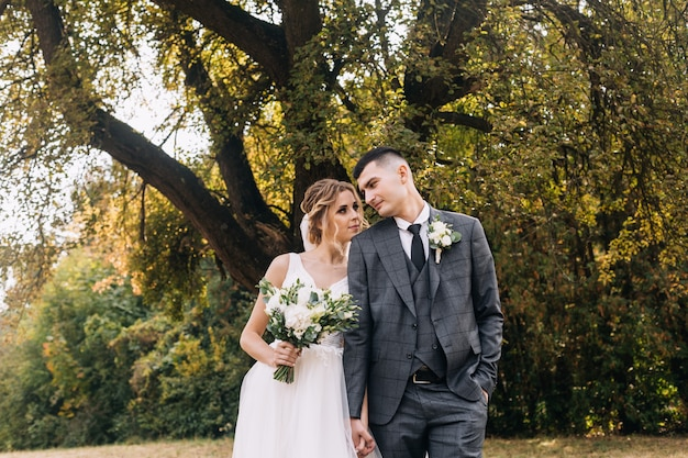 Couple in love celebrating their wedding in the park