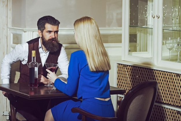 Couple in love dating in restaurant relationship of sensual couple