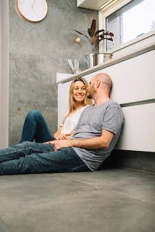 Couple in love on floor in kitchen