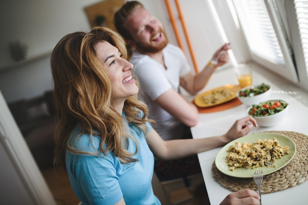 Couple in love  having breakfast in the morning and smiling