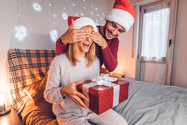 Couple in love having fun at christmas day