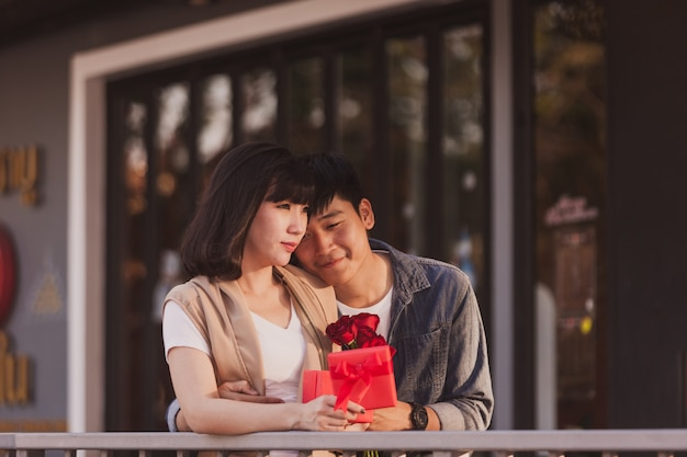 Couple in love holding a red gift