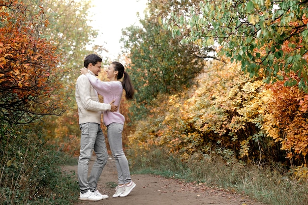 Couple in love hugging on beautiful autumn day in park. happy moments of life