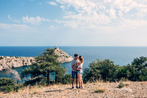 Couple in love hugging and kissing on holiday