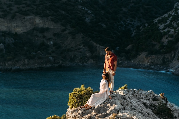 Couple in love on an island off the coast.  young couple by the sea. man and woman travel to beautiful places. couple in love at the lagoon. honeymoon trip. relax on the island. wedding travel
