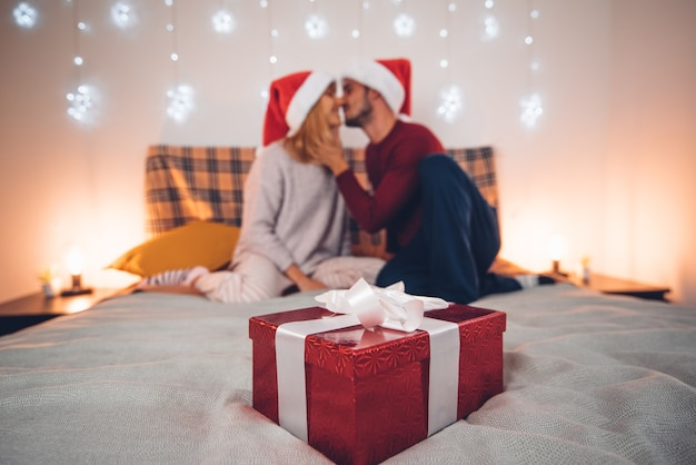 Couple in love kissing celebrating christmas time together