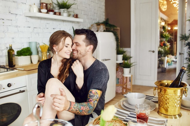 Couple in love in the kitchen in the morning