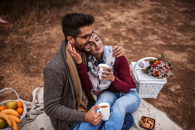 Couple in love at picnic in autumn.