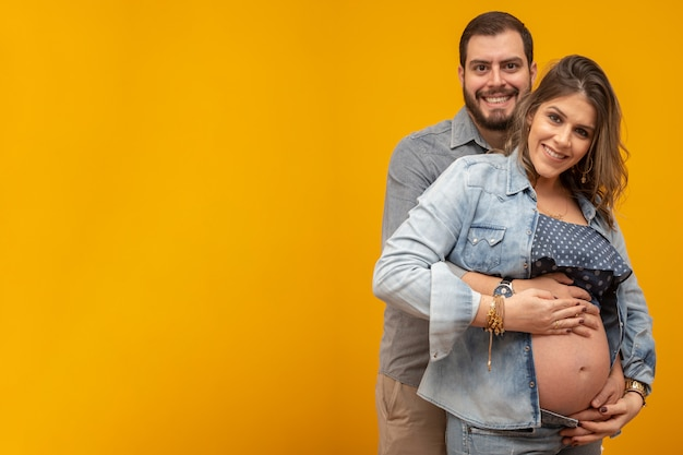 Couple in love, pregnant woman.