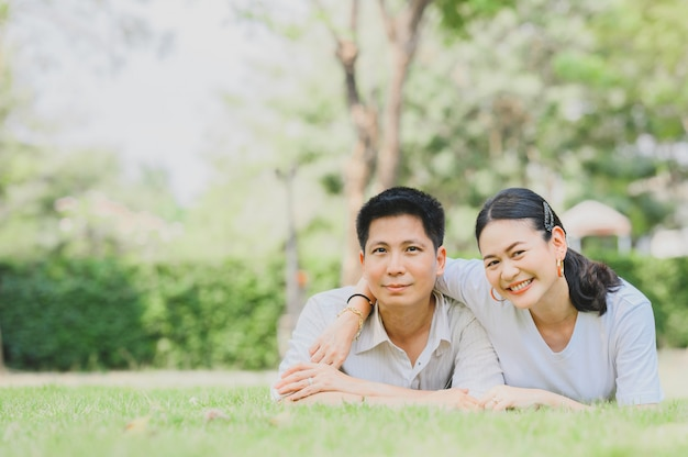 Couple in love relaxing on green grass