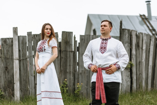 A couple in love in russian traditional dresses