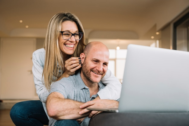 Couple in love using laptop
