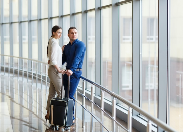 Couple in love on vacation. couple standing in the airport.