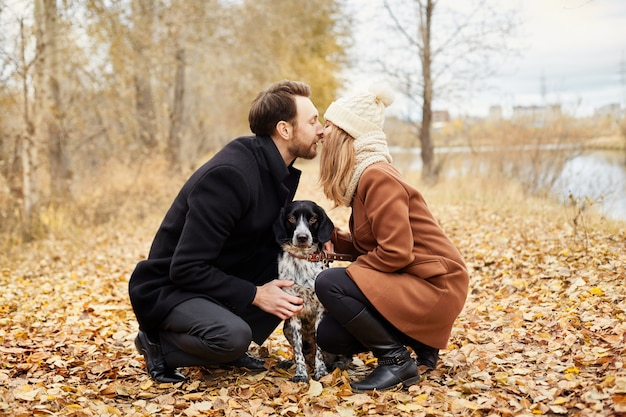 Couple in love valentines day walking dog in park